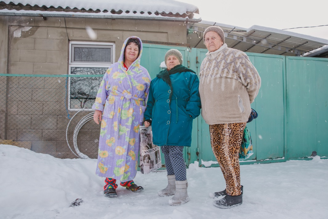 Three women suffering from diabetes stand in the snow in Kyrgyzstan.