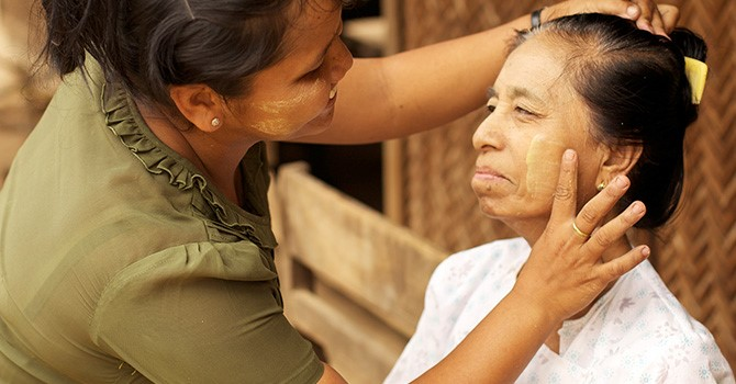 An older woman receiving home based care in Myanmar.