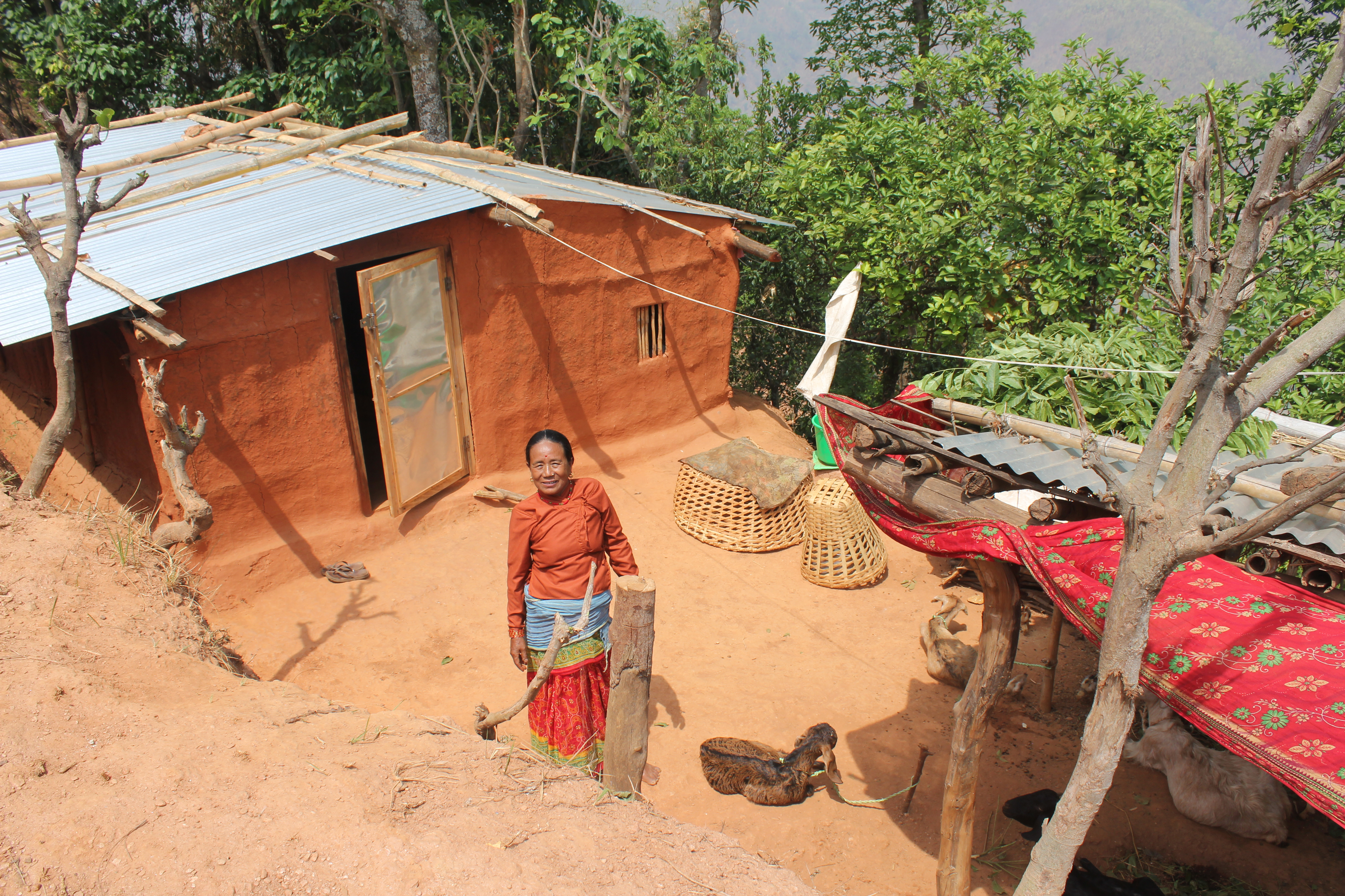 Kanchi outside her house in Nepal.