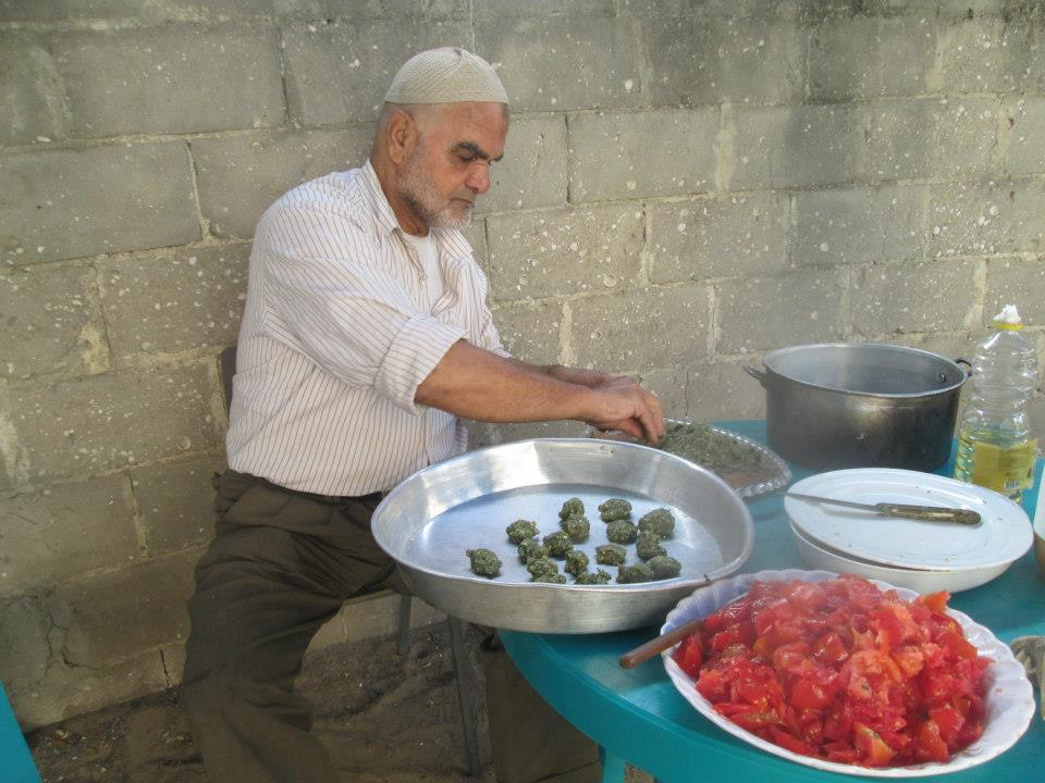 Talal Abu makes breakfast at the age friendly space.