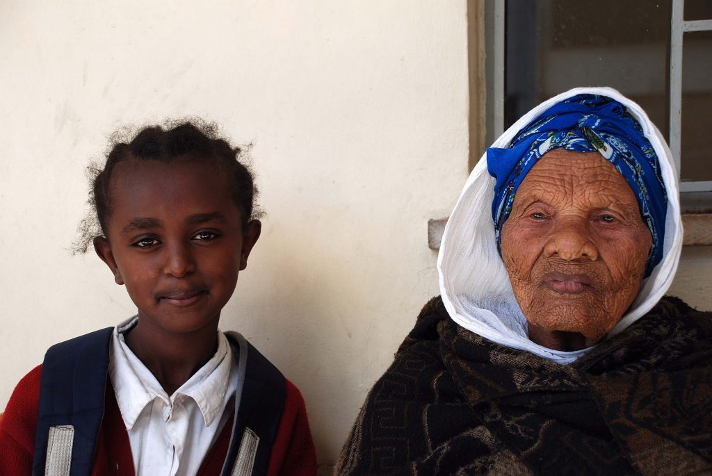 An older Ethiopian woman and her daughter.