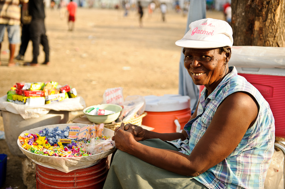 An older woman with her food stall.