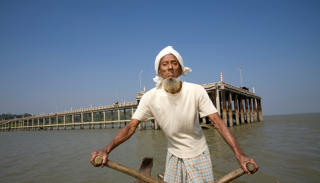 Tajor transports people in his boat in Bangladesh.