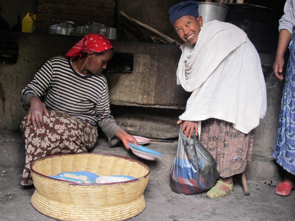 Volunteers pack food to take to older people