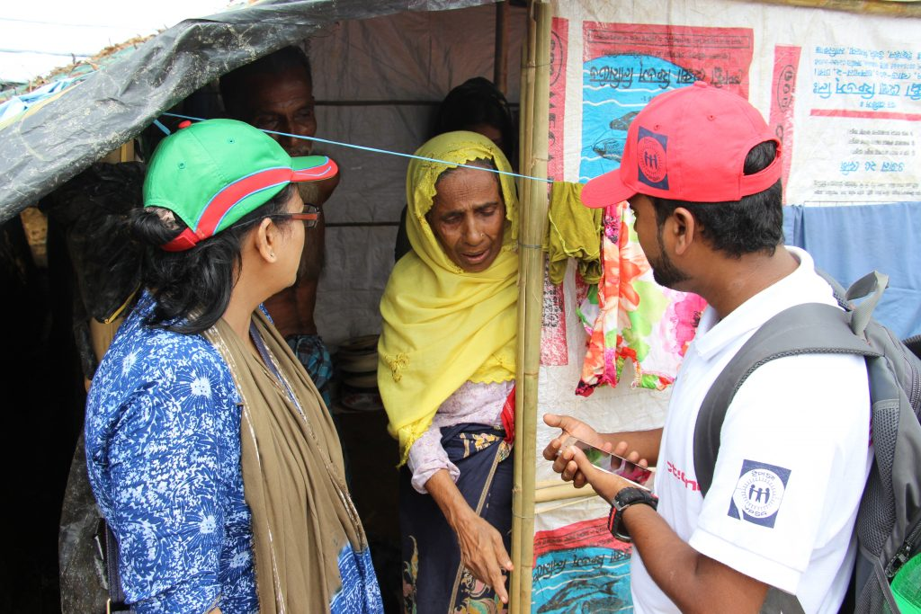 Rabeya, Country Officer for Bangladesh, speaks to an older person about their needs